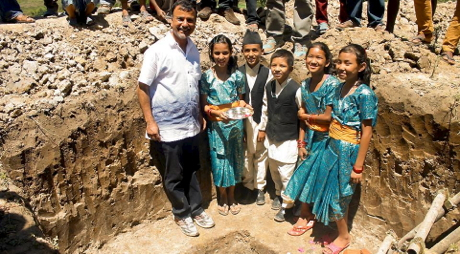 Children lay the cornerstone of the new J & K Village.
