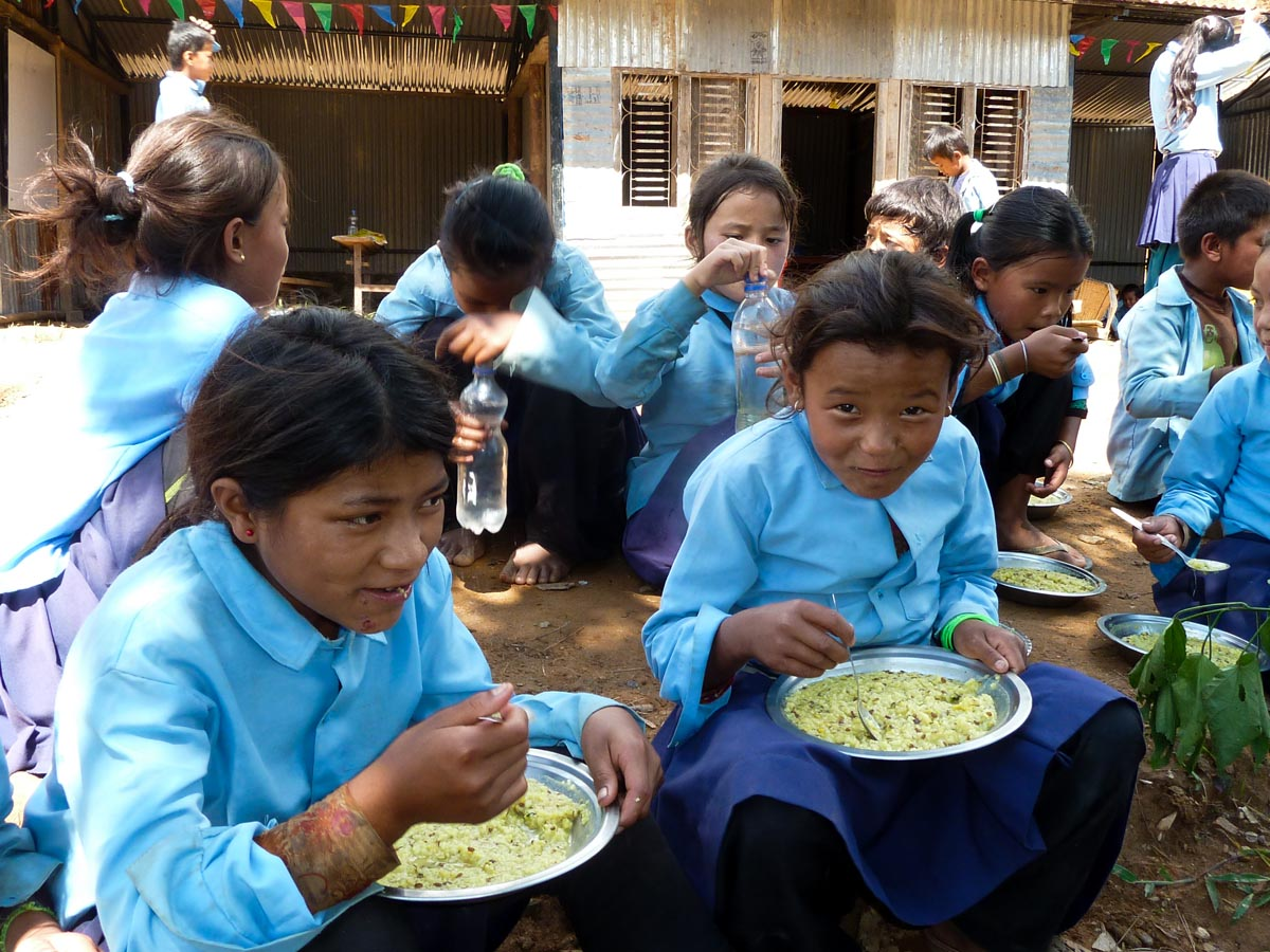 Girls enjoying their midday meal Food and Nutrition