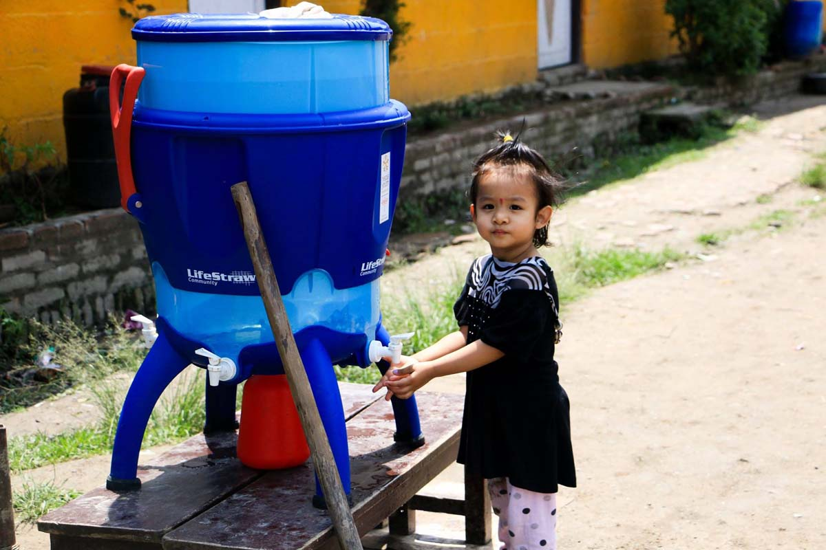 Young girl collecting water Emergency Relief